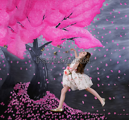 carefree girl in dress against pink