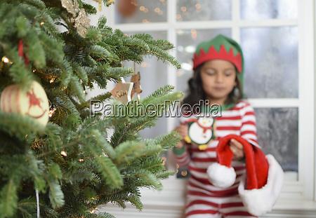 girl in pajamas with santa hat