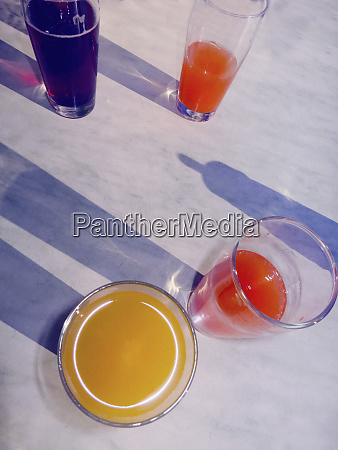 variety of fruit juices in glasses