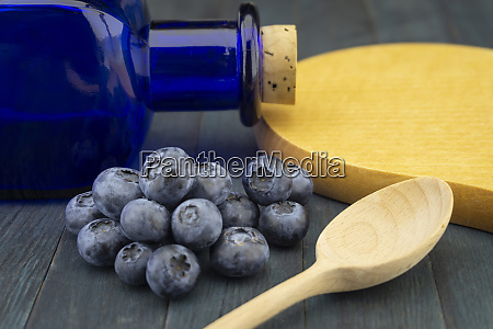 fresh blueberries and wooden spoon