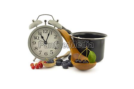 culinary still life with clock pot
