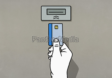 hand inserting chip credit card into