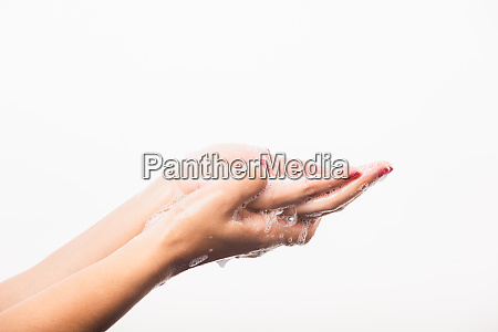 woman washing hands by soap for