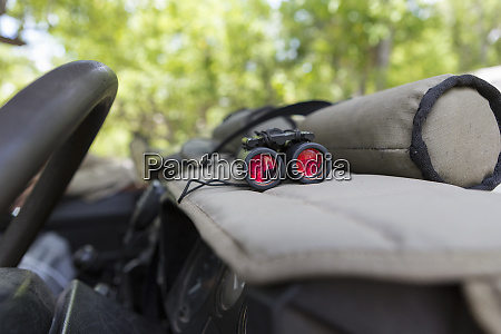 binoculars on the dashboard of a