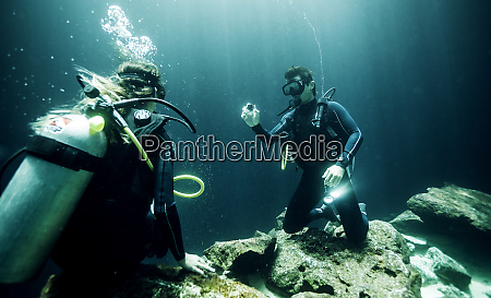 underwater view of two divers wearing