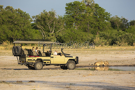 a safari vehicle and passengers very