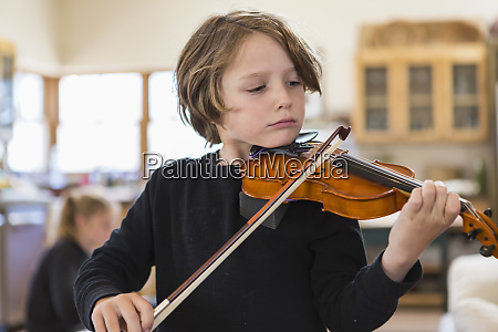 six year old boy playing violin