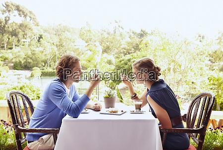 glamorous caucasian couple eating in restaurant