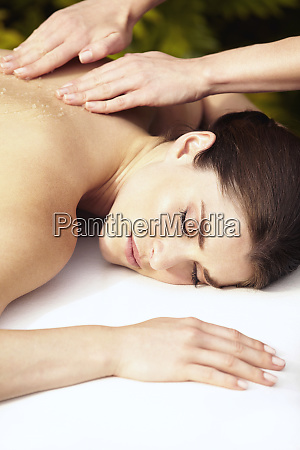 caucasian woman getting massage with body