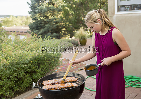 11 year old girl grilling ribs