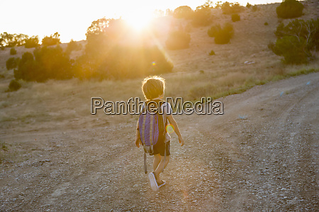 4 year old boy hiking at