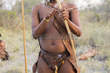 a san bushman holding bow and