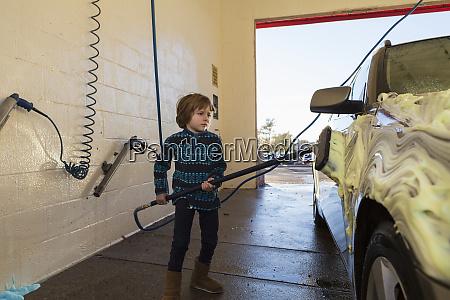 4 year old boy washing a