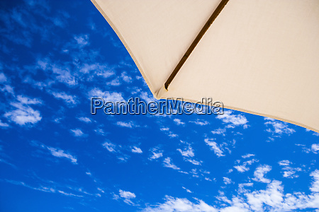 a sun umbrella corner against a