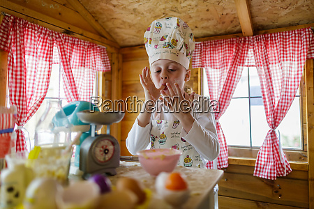 young girl in wendy house liking