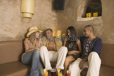group sitting on couch with drinks