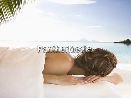 caucasian woman waiting for massage