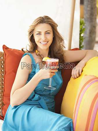 beautiful well dressed woman drinking a