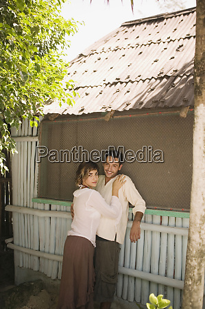young couple hugging outdoors