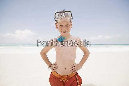 young boy with snorkel smiling at