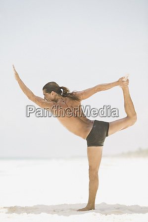 young man doing yoga on the