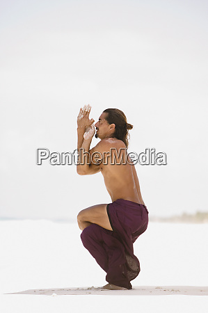 young man practicing yoga on the