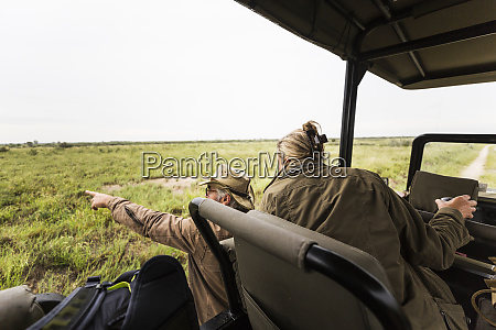 adult woman and a safari guide