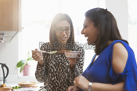 indian women cooking in kitchen