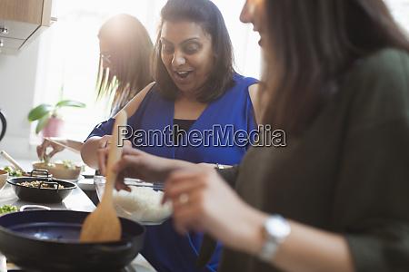 women preparing indian food in kitchen