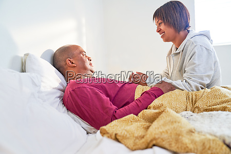 caring wife checking on sick husband