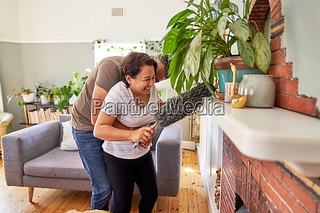 affectionate playful mature couple with duster