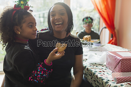 portrait happy mother and daughter eating