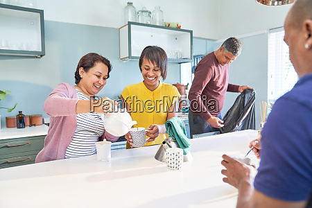 happy women friends enjoying tea in