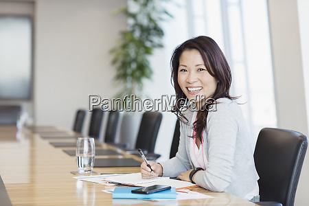 portrait confident smiling businesswoman working in