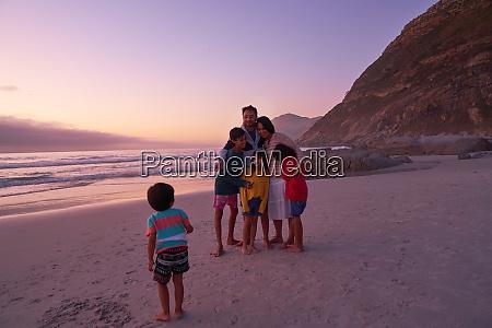 happy family on ocean beach at