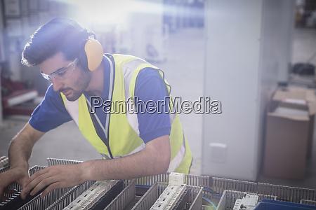 focused male engineer wearing ear protectors