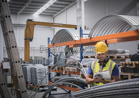 male supervisor with clipboard in steel