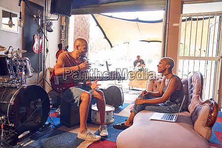 musicians talking and practicing in garage