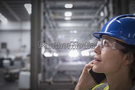 female worker talking on cell phone