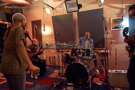 musicians practicing in recording studio