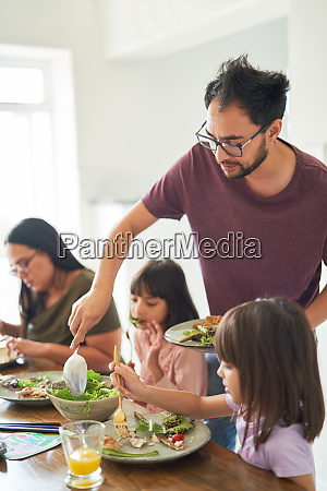 family eating salad lunch at table