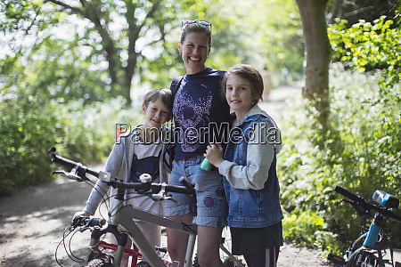 portrait happy mother and sons enjoying