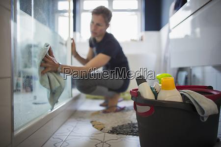 woman cleaning bathroom