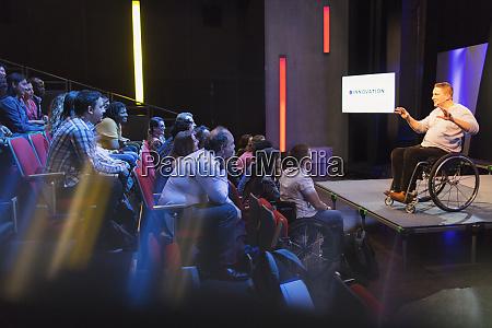 attentive audience listening to female speaker