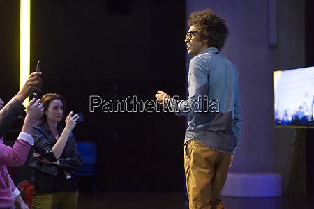 male speaker talking on stage