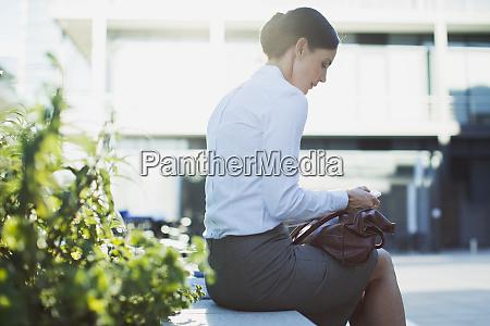 businesswoman text messaging outdoors
