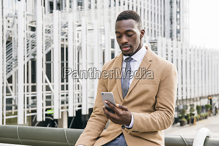 young businessman using smartphone in the