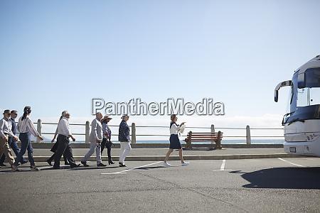 tour guide leading active senior tourists