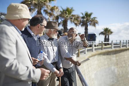 active senior men tourist friends talking