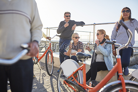 active senior friend tourists with bicycles